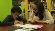 Wellesley student works with elementary student at desk