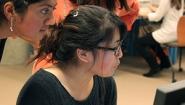 Wellesley students look at computer screen