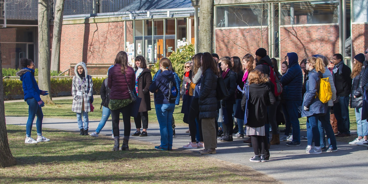 A group of perspective students and their families take a tour of Wellesley during Open Campus.
