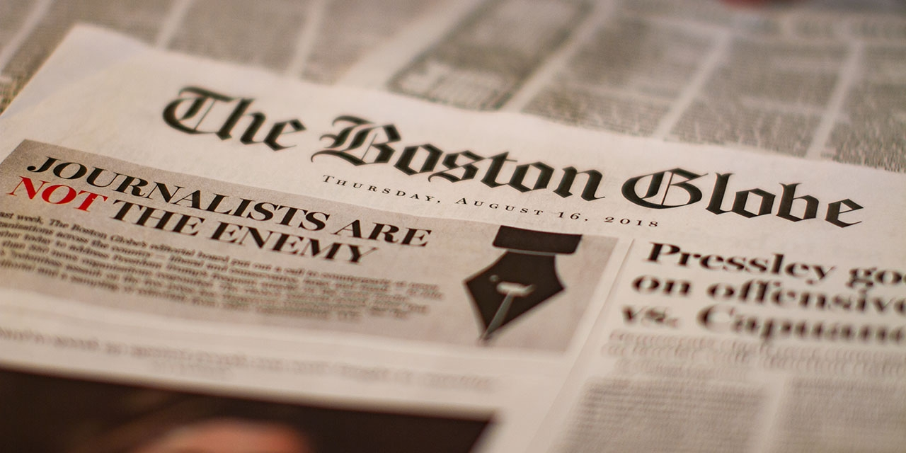 """The front page of the Boston Globe. It reads """"Journalists are not the enemy."""""""