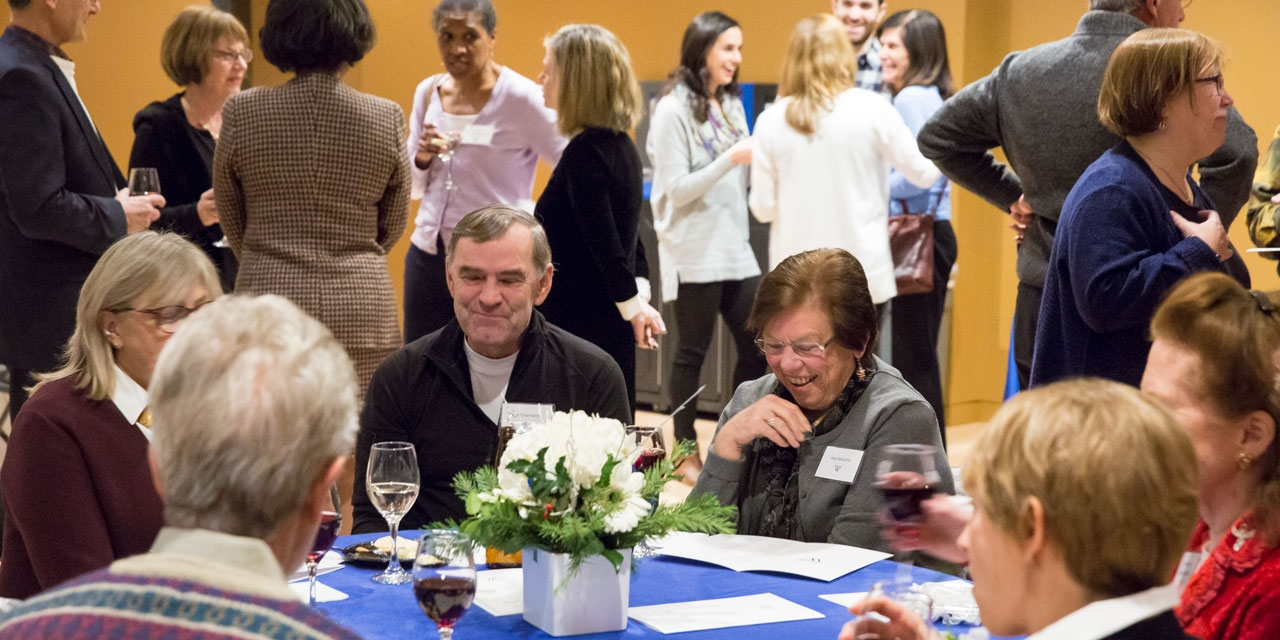Retiring administrative staff and their guests gathered for a reception in their honor