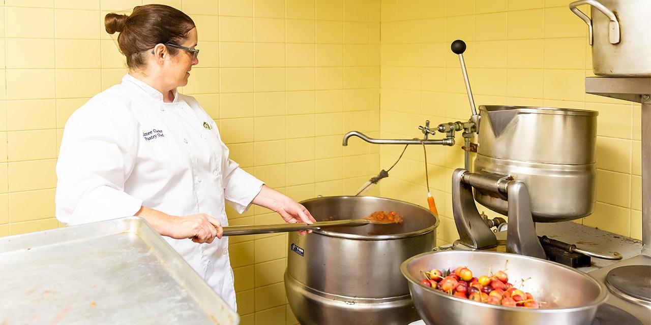 Wellesley pastry chef mixes crabapple sauce.