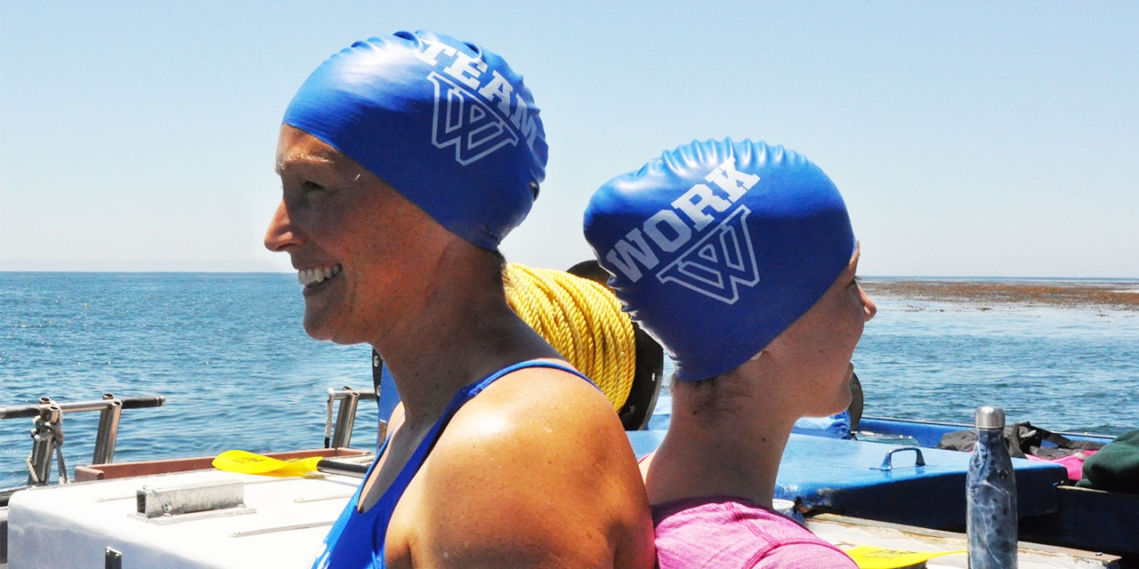 Two Wellesley alumnae in swim caps