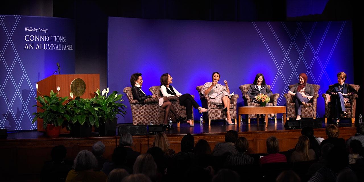alumnae panelists on stage