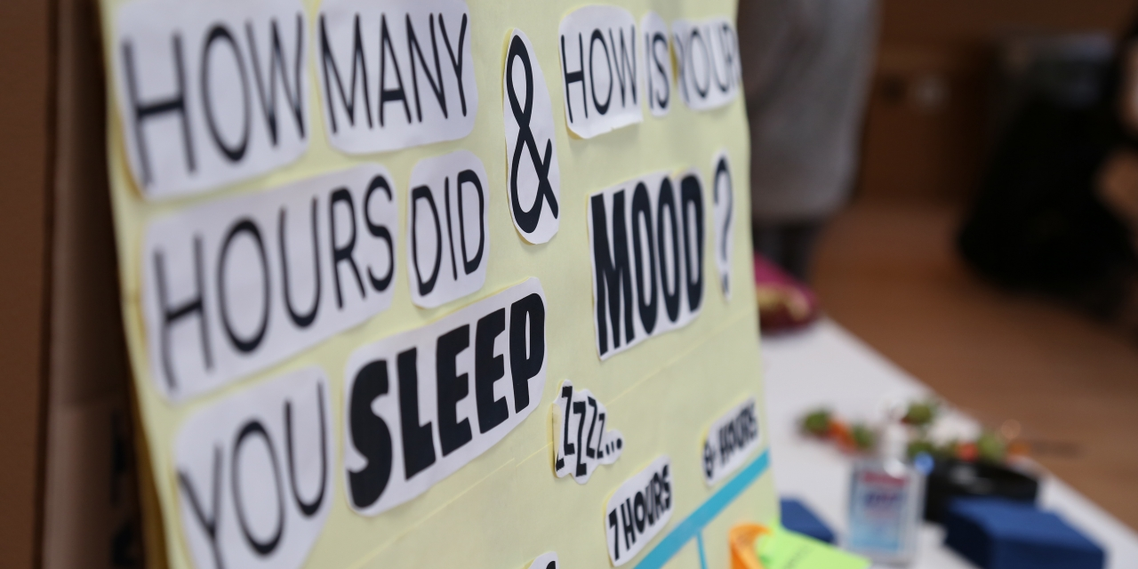 "A poster that says, ""How many hours do you sleep? and How is your mood?"""