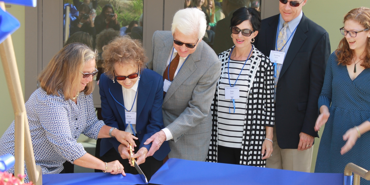 A ribbon cutting ceremony at the Butler Boathouse