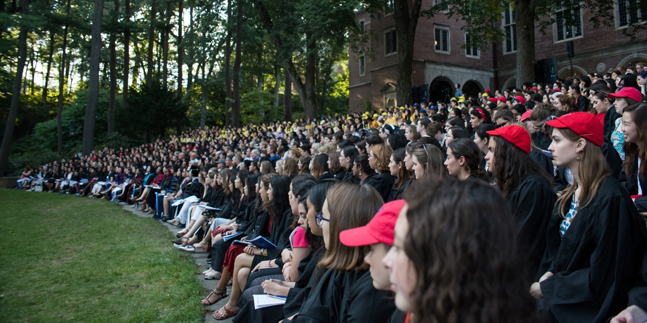 Students sit in Hay Amphitheater listening to remarks.
