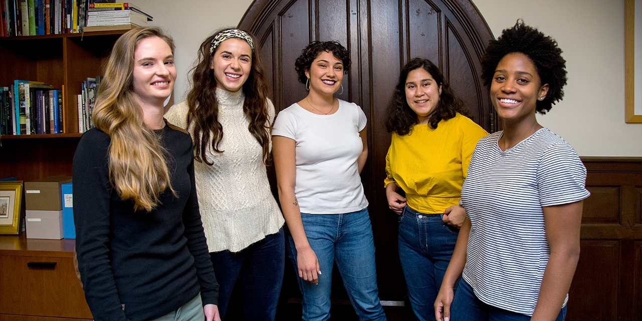 Five students stand together in the provosts office