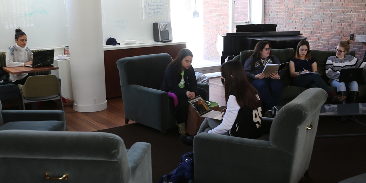 Farther east, past the Science Center, students gather at lunchtime in the renovated Freeman living room.