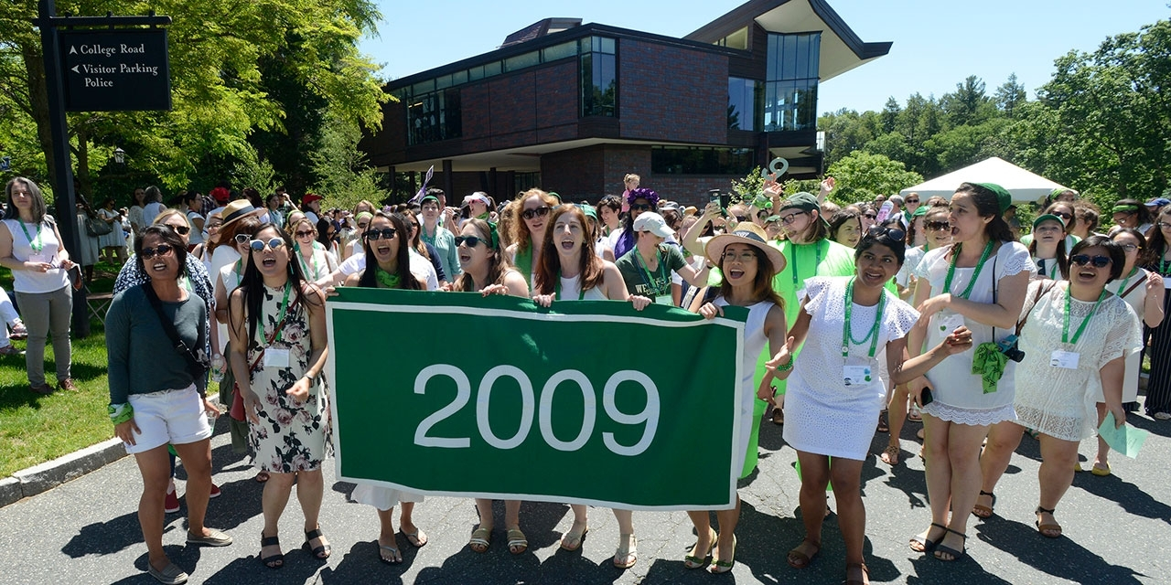 Members of the class of 2009 walk by LuLu during the Sunday reunion parade. They wear white