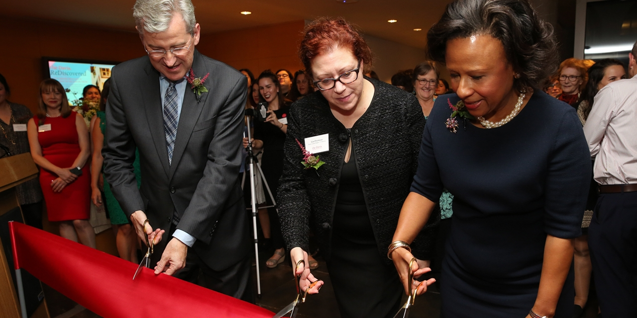 cutting the ribbon to reopen the Davis