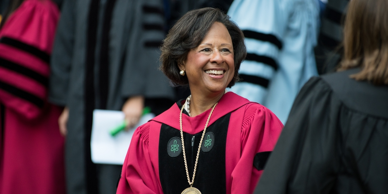 President Paula A Johnson smiles from her seat at convocation
