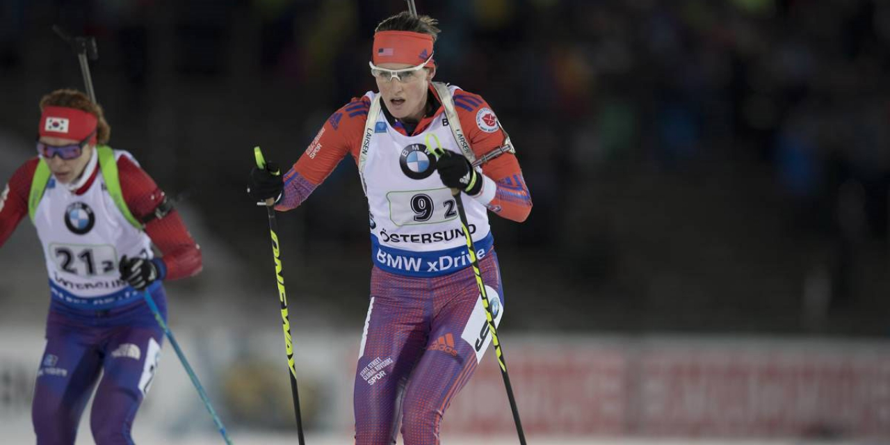 Clare Egan skis at a biathlon event