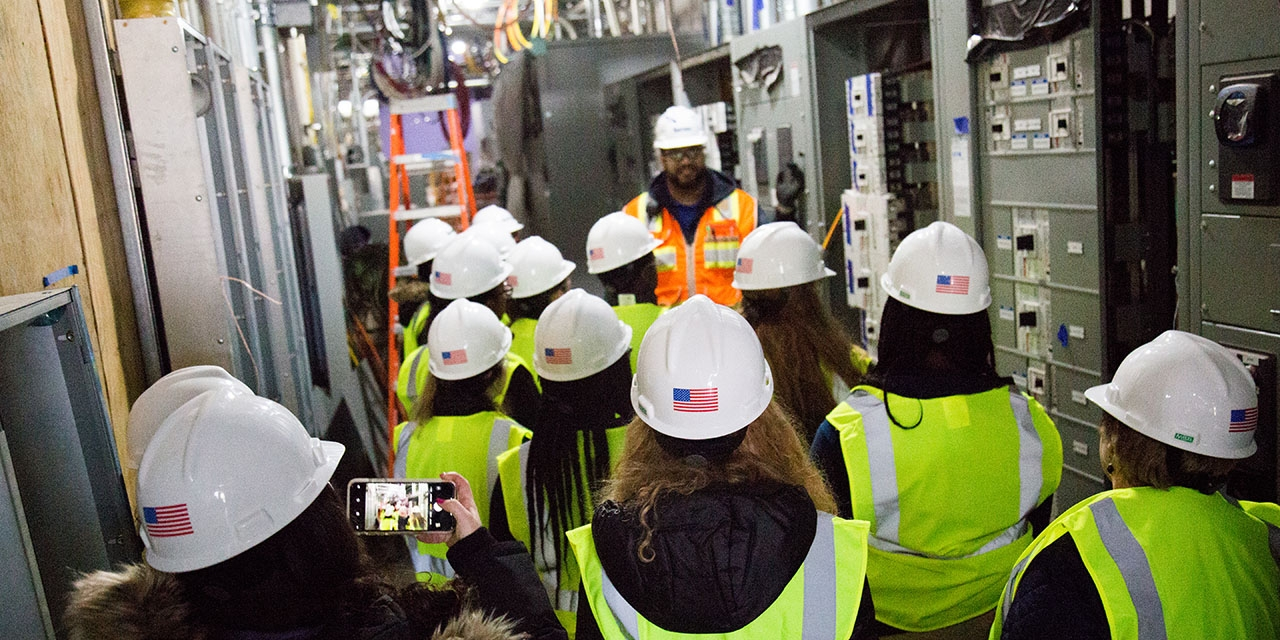 A superintendent for Turner construction leads a tour through the Science Center