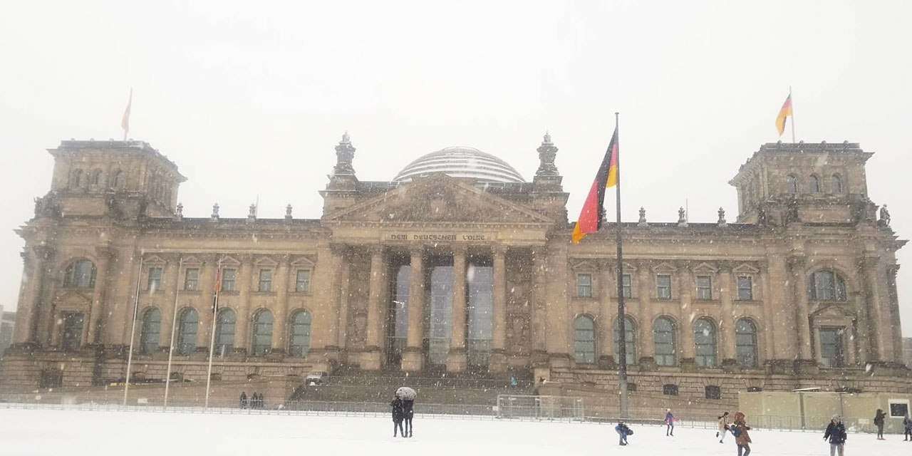 The Reichstag building in the snow.