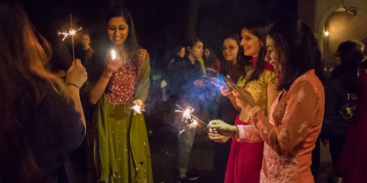 Students celebrate Diwali by Alumnae Hall