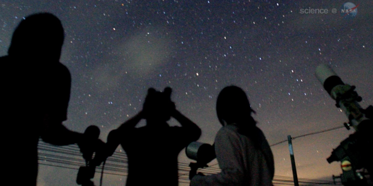 Star gazers watch the night sky during a meteor shower.