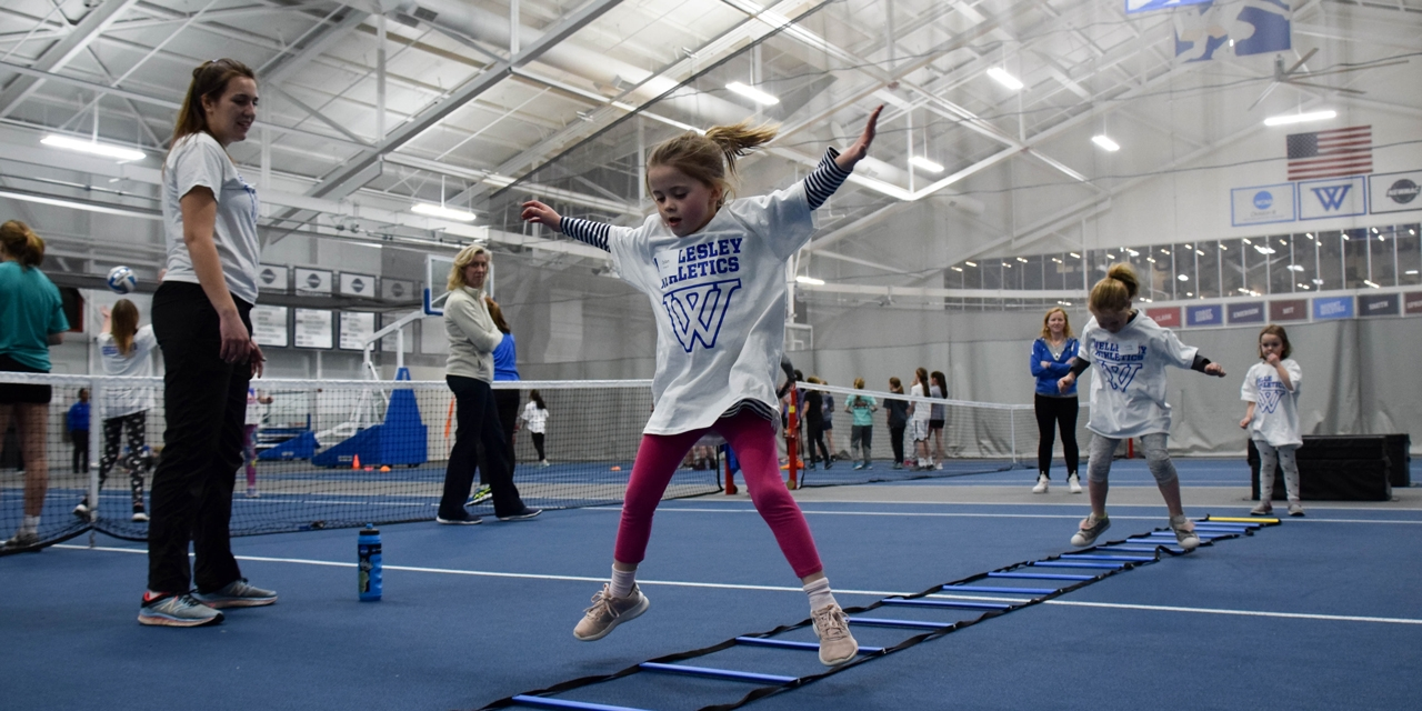 a young girl works through a relay race