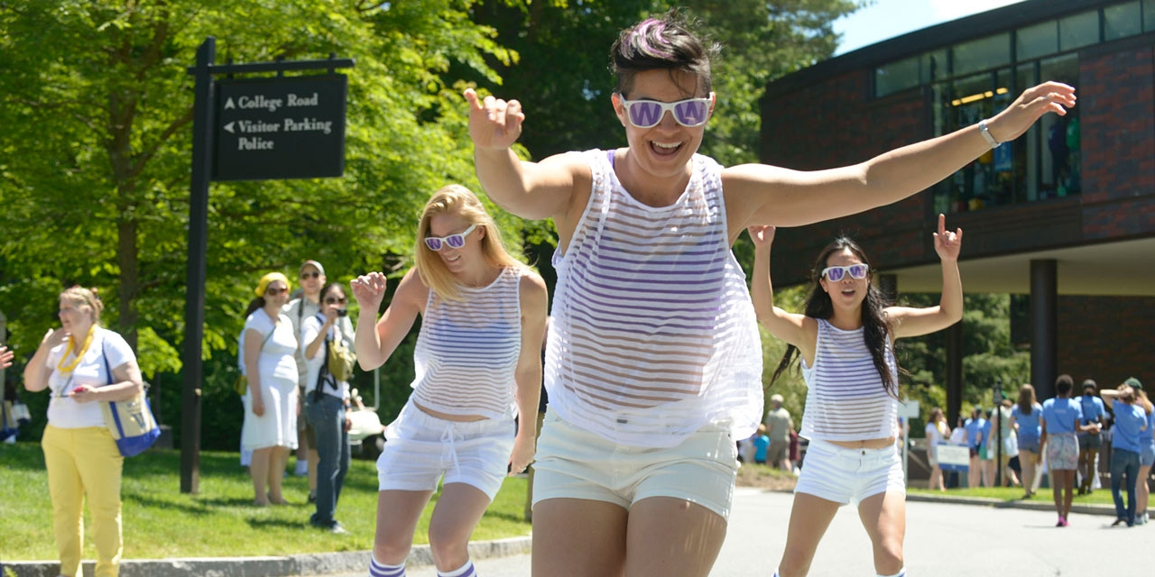 Three Wellesley alumnae skate by LuLu Chow Wang Campus Center at Reunion 2013.