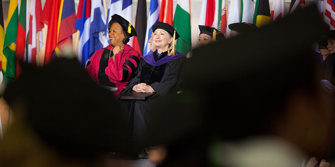 President Johnson and Secretary Hillary Clinton talking at Wellesley's Commencement
