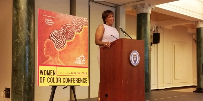 Liz Walker speaks at a podium as the keynote speaker at Wellesley's first ever Women of Color Conference.