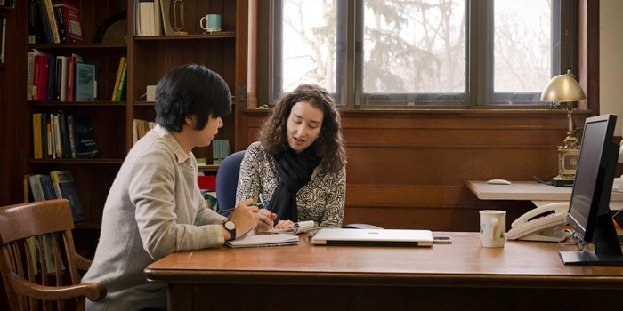 Sophie Sun '14 and director Cassandra Pattanayak work together in library office