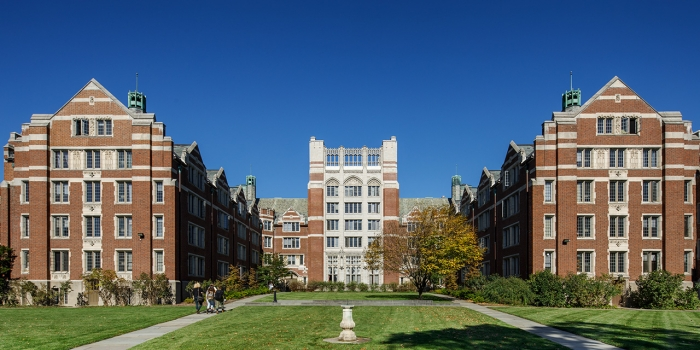 An image of TowerCourt. Three students walk toward the building