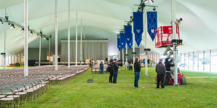 staffers setting up the Inauguration tent