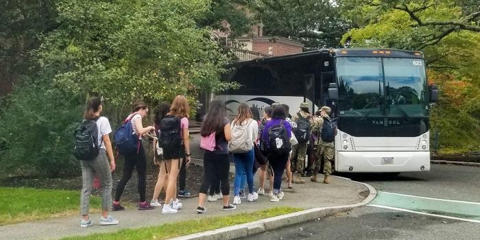 Students board a bus outside Lulu
