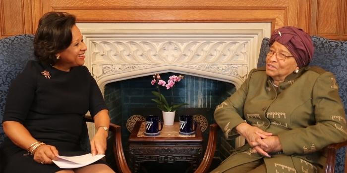 President Johnson sits with Ellen Johnson Sirleaf in an office.