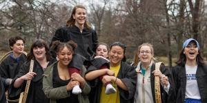 A Wellesley Senior is carried by her classmates after winning the hooprolling competition.