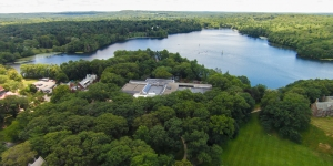 An ariel photo of campus with Lake Waban in the distance