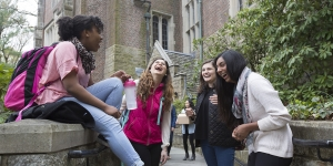 students laughing outside Founders Hall