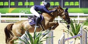 Isheau Wong '11 competing in equestrian jumping at the Rio Olympic Games.