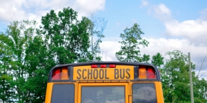 The outside view of the back of a school bus.