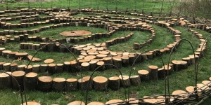 The outdoor labyrinth, which has five concentric rings around the center, is the first of its kind at Wellesley. Measuring roughly 32 feet in diameter, it is constructed from wood rounds and branches from trees that have fallen on campus.