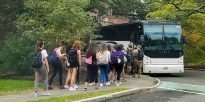 Students board a bus outside Lulu