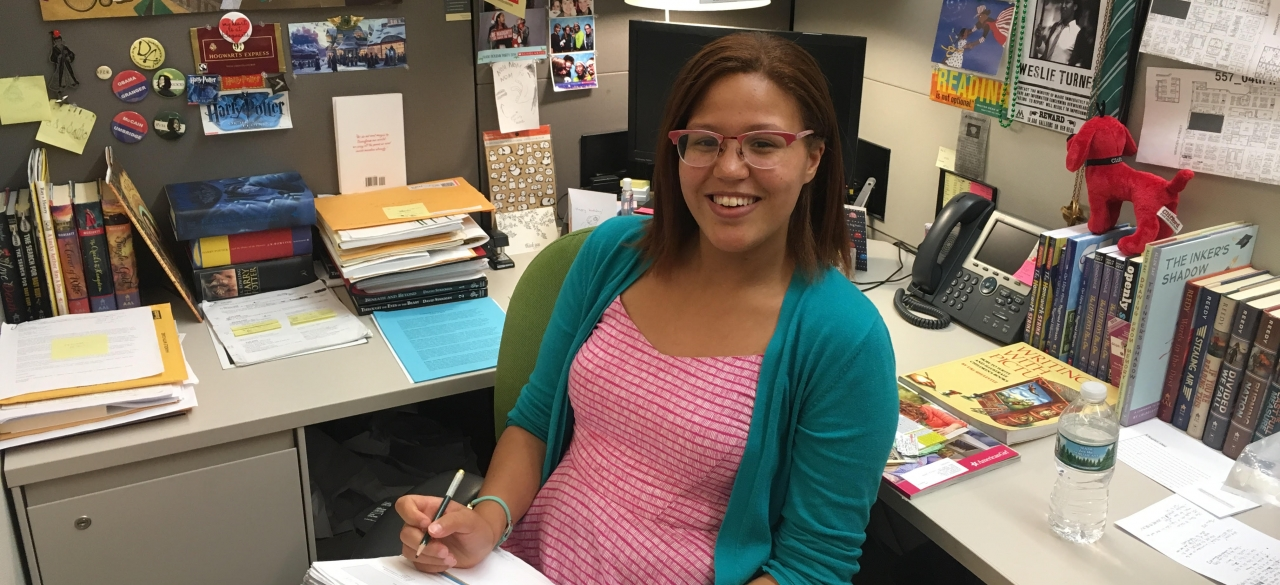 Maya Marlette '16 with story submissions at Scholastic