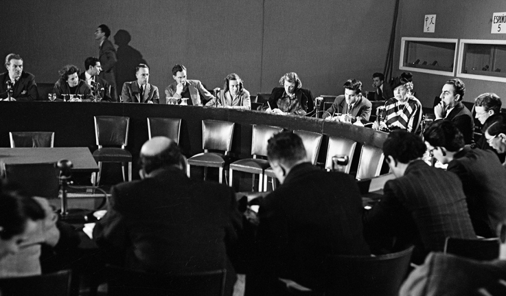Eleanor Roosevelt and other leaders sit in conference after completing the Declaration of Human Rights.