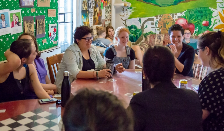 Ray Acheson sits with students at El Table