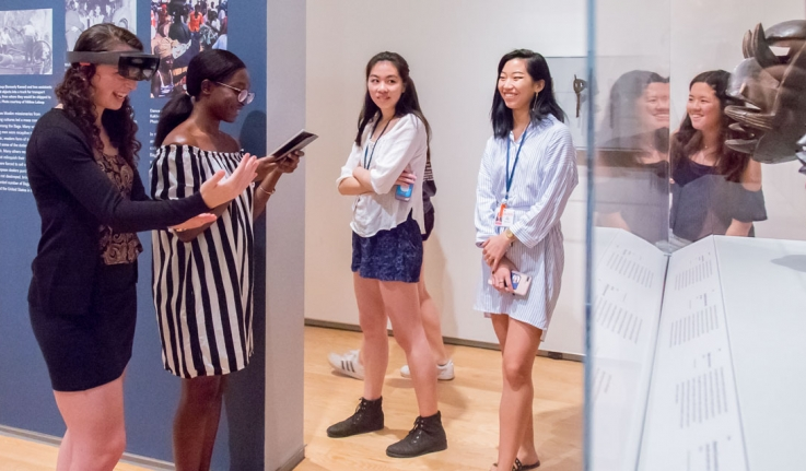 Student Interns use augmented reality technology at the Davis Art Museum.