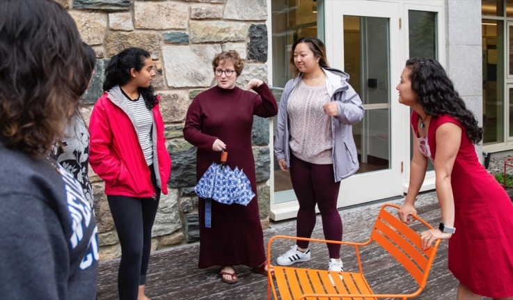 Helen Wang talks with a group of students outside Bates Hall.