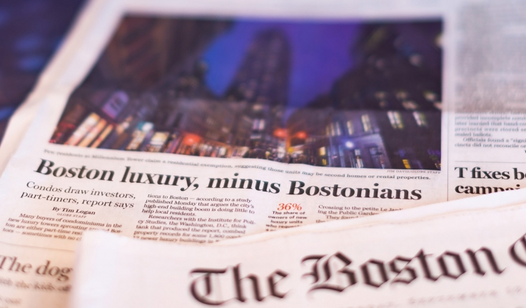 "The front page of the Boston Globe, which reads ""Boston Luxury, Minus Bostonians."""