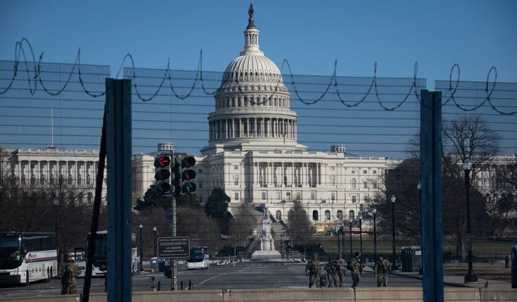 The U.S. Capitol Building behind security fencing in Washington, D.C., following the January insurrection.