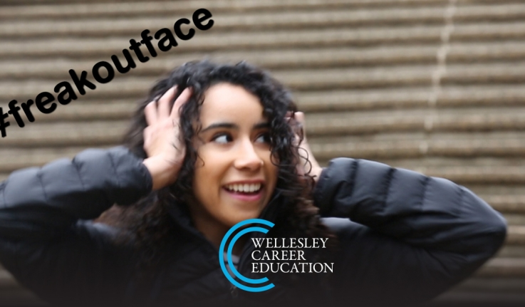 Wellesley student Natalie Catalan '18 stands by a staircase near Wellesley's academic quad with a look of panic in her eyes