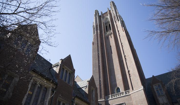 Wellesley College's Galen Stone Tower and Green Hall against a blue sky