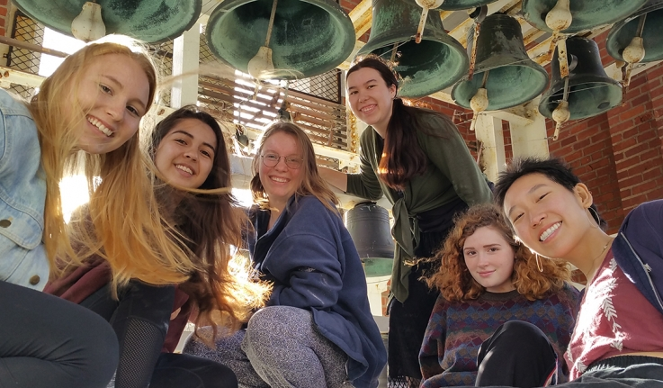 Wellesley students in Galen Stone Tower with carillon bells
