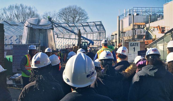 A group of young women take a tour of the science center construction project