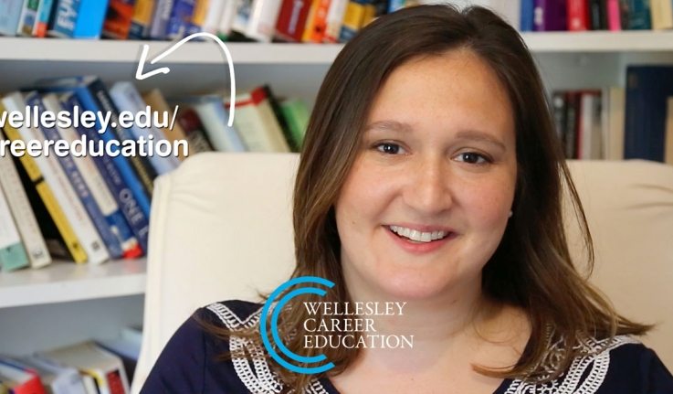 A Wellesley alumna sits in front of a bookcase. Text on screen reads: wellesley.edu/careereducation