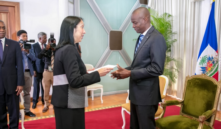 Ambassador Michele Sison '81 presents her credentials to the president of Haiti.